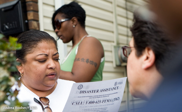FEMA field workers distribute disaster information in a Paterson neighborhood